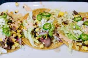 Grilled Carne Asada Tacos with Roasted Corn Salsa and Chipotle Crema