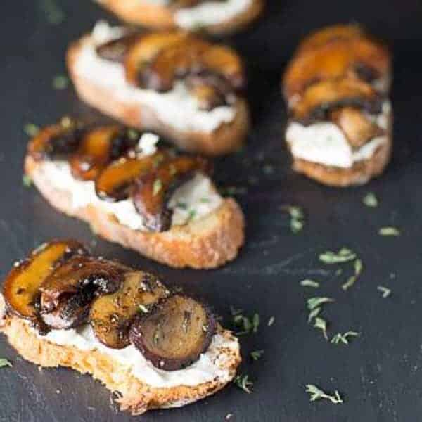 sliced crostini slathered with a lemon scented goat cheese then topped with golden brown mushrooms and thyme.