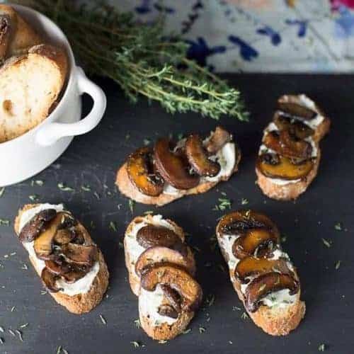 assortment of mushroom bruschetta appetizers, with goat cheese. recipe by foodoology geek.