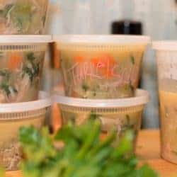 Easy Turkey Soup meal prep. Stored in plastic restaurant style soup containers for easy storage.