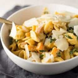 Bowl of Creamy Butternut Squash Alfredo with Pancetta and Kale
