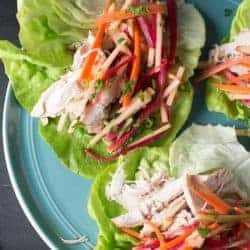 Lemongrass Chicken Lettuce Wraps, shredded chicken with a carrot and apple matchstick slaw. Served on lettuce cups. recipe by foodology geek.