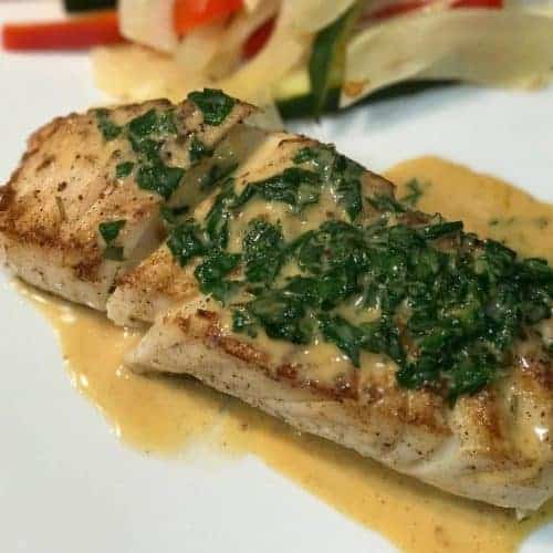 Pan Seared Halibut With Citrus Cream Sauce recipe by foodology geek.