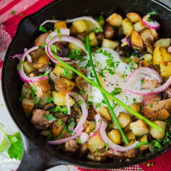 Duck hash with poached eggs, pickled onions, and duck fat potatoes.