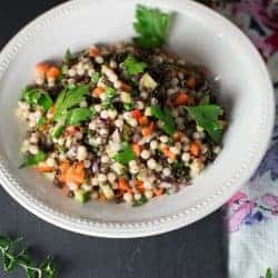 Vegetarian couscous salad recipe made with lebanese couscous, carrots, cucumbers, black lentils, parsley and a red wine viniagrette. recipe by foodology geek.