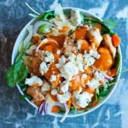 Buffalo chicken salad bowl with blue cheese and franks' red hot sauce. by foodology geek