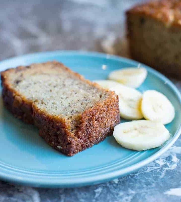 Slice of Papa's Banana Bread with a few sliced bananas. by foodology geek.