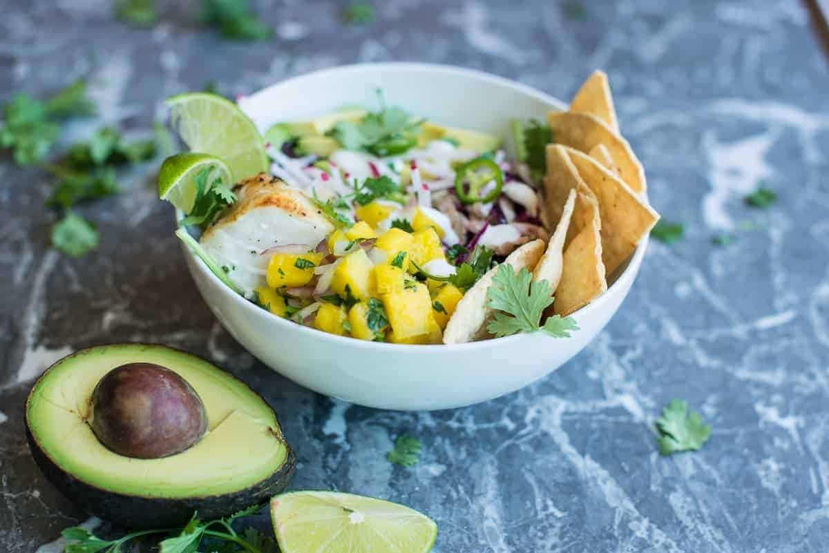 Tequila Lime Fish Taco Beast Bowl with Mango Salsa, Creme Fraiche, Avocado and Mexican Slaw