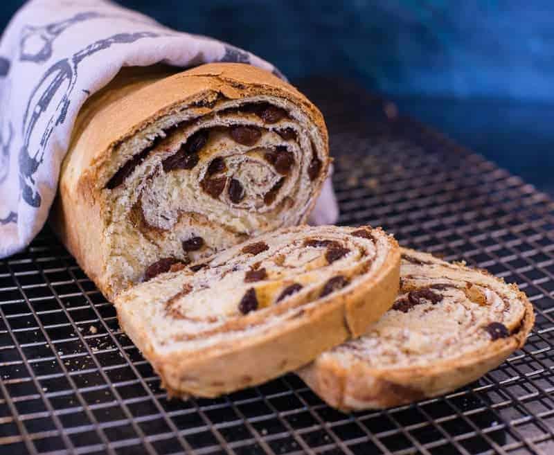 Raisin bread recipe, sliced on a baking rack by foodology geek.