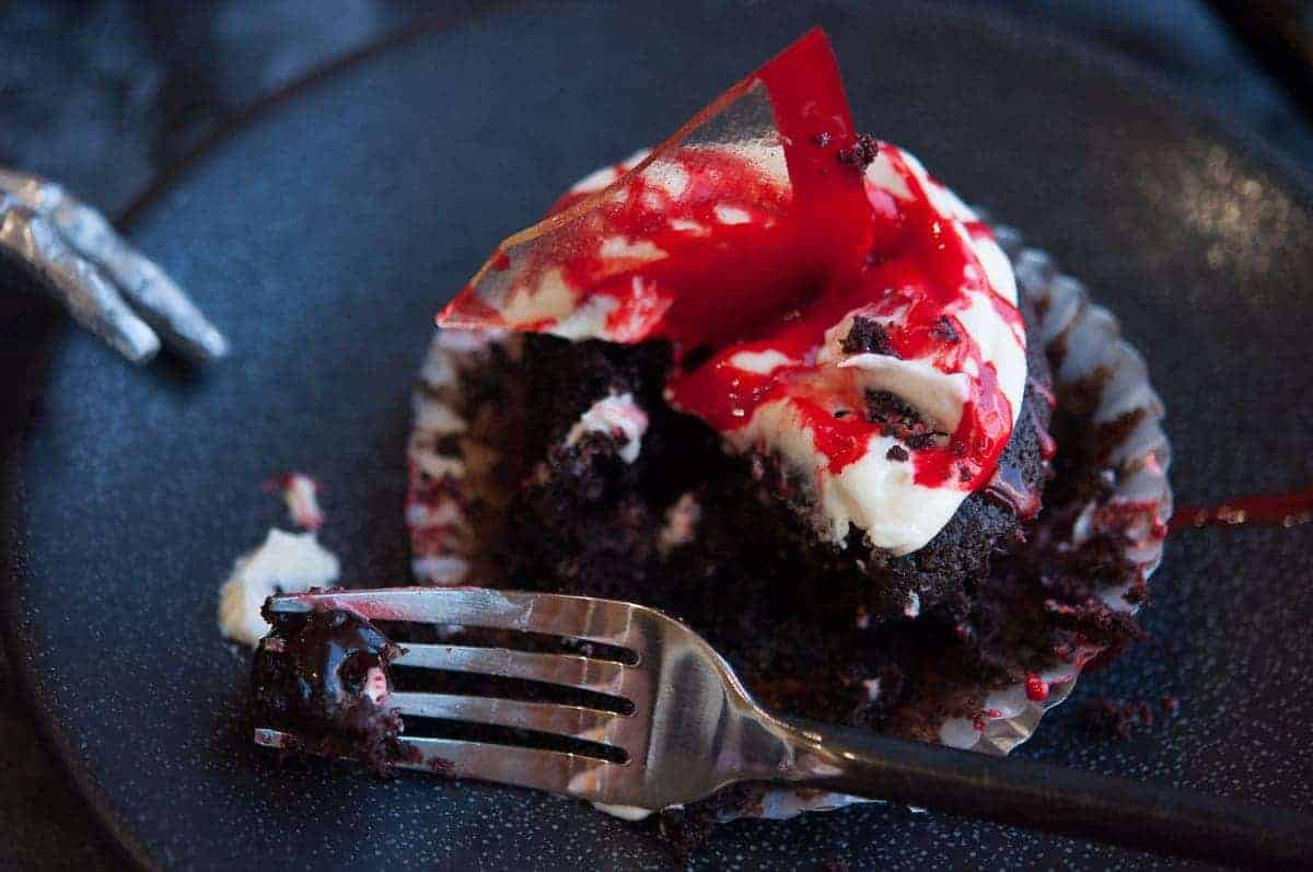 Cherry filled devils food cupcakes. Halloween party ideas.
