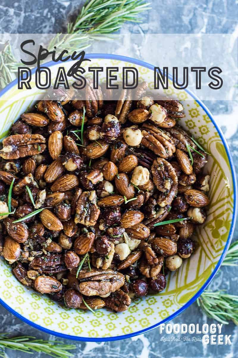 spicy roasted nuts in a bowl. pinterest image by foodology geek