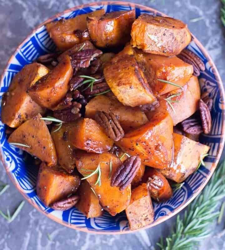 Paleo Maple Roasted Holiday Sweet Potatoes made with rosemary, pecans, and maple syrup. by foodology geek.