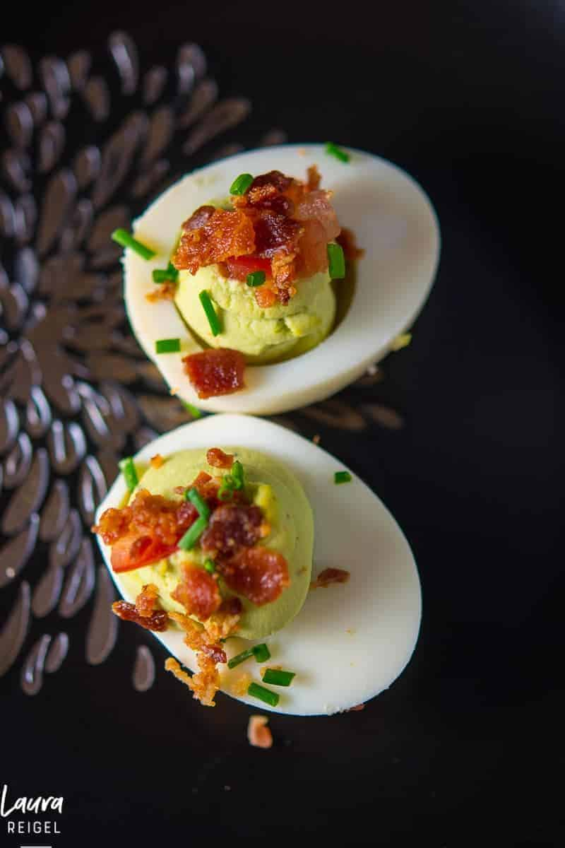 Deviled Avocado Easter eggs with crispy bacon. Is your mouth watering right now?