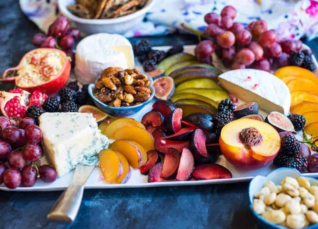 Colorful fruit and cheese plate