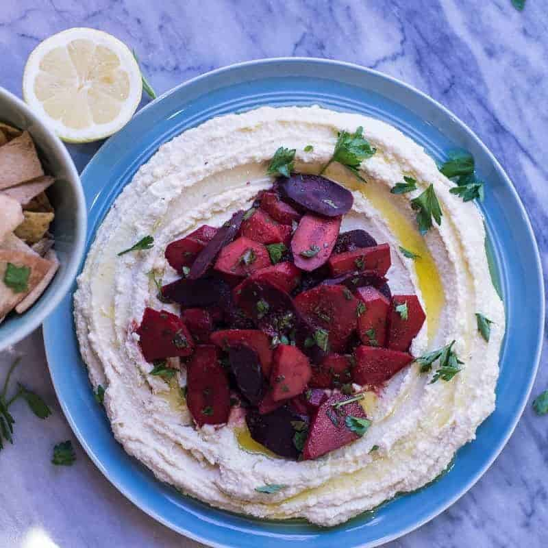 Moroccan spiced carrots on top of homemade hummus