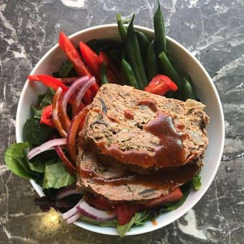 Paleo Meatloaf power bowl recipe with fresh vegetables and a tomato balsamic vinaigrette.