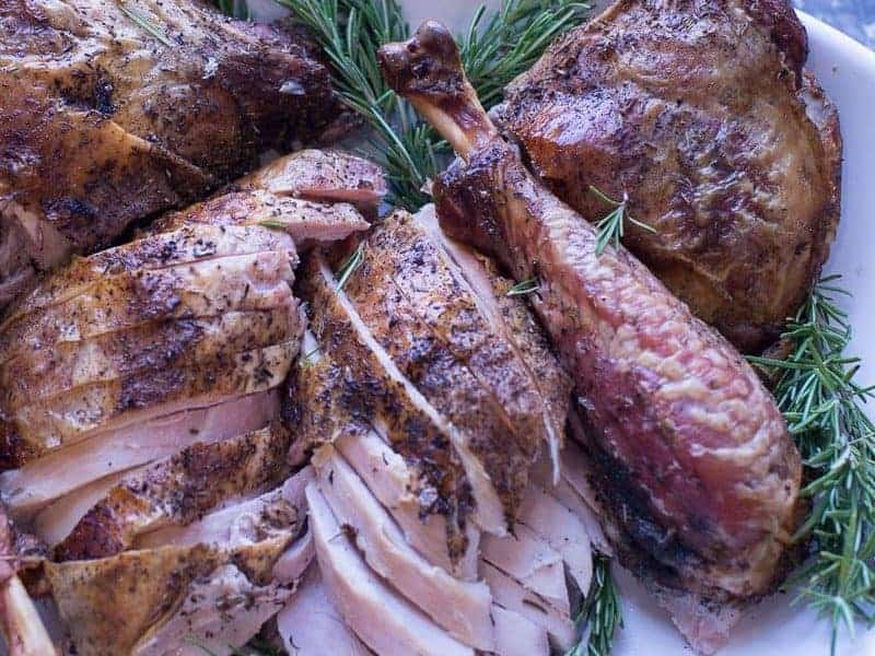 spatchcocked thanksgiving turkey plated recipe and featured image