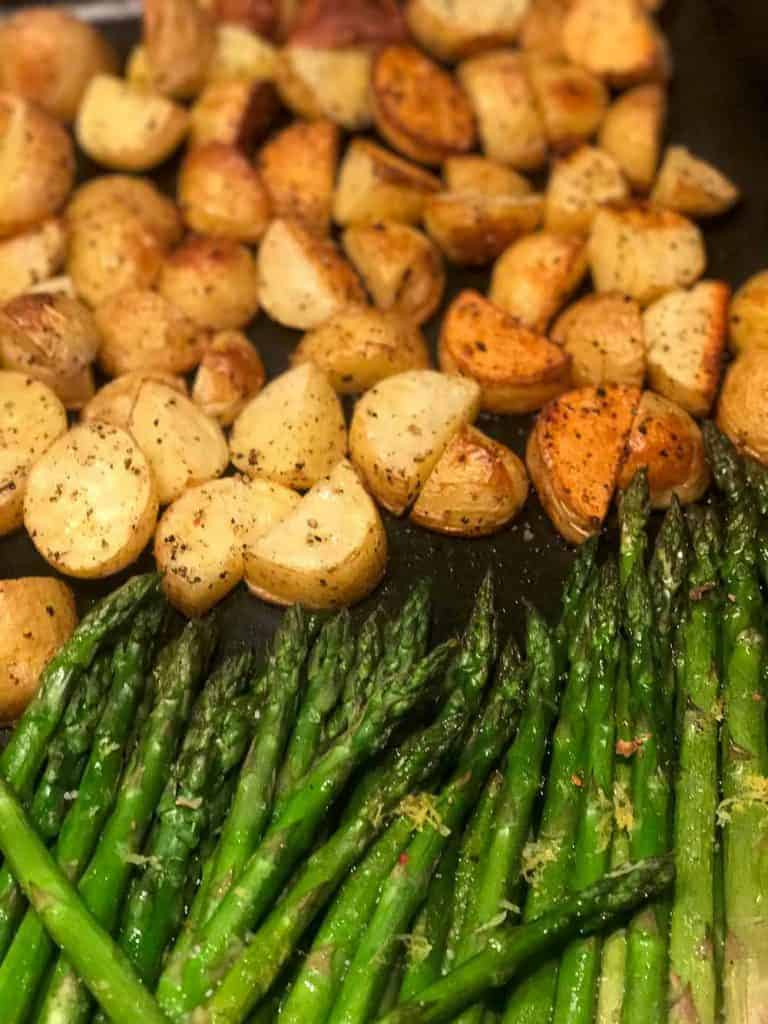 roasted sweet potatoes and asparagus on a baking sheet.