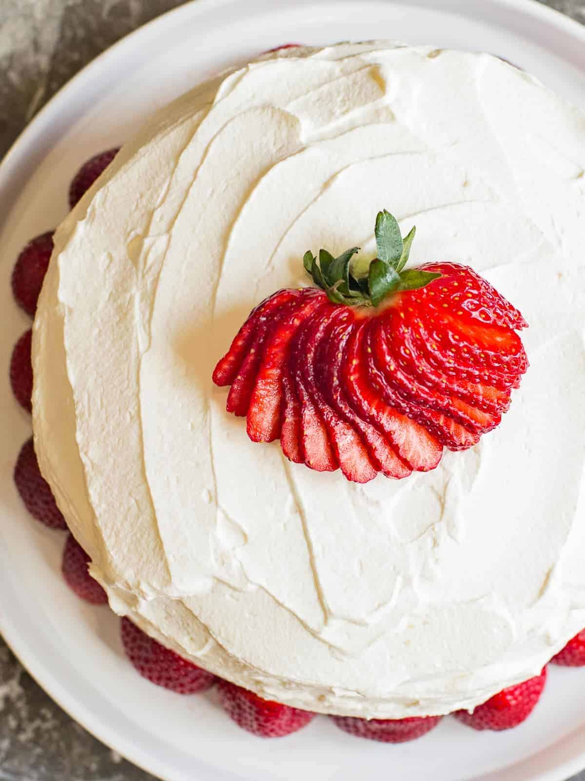 Fresh Strawberries and Cream Cake with whipped cream frosting