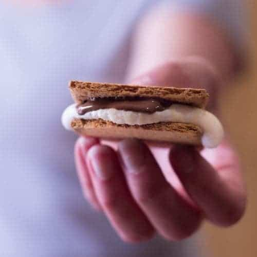 Woman holding a melty-gooey S'mores!