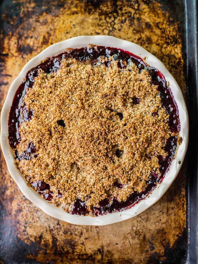 Fresh Cherry Crumble Baked with a Gluten-Free Almond and Oat Crumble tobbing.