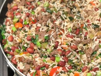 Puerto Rican Dirty Rice with small red beans in a pan.