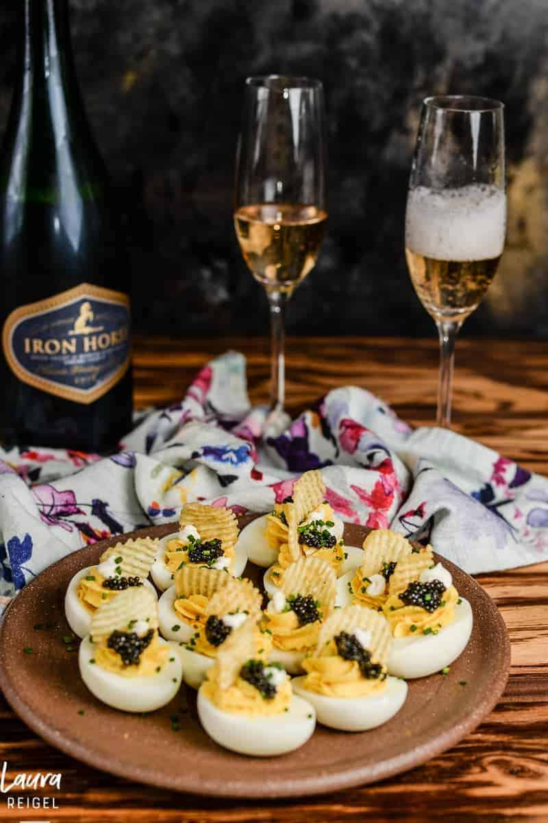 Deviled eggs with caviar and potato chips. Always serve with champagne.