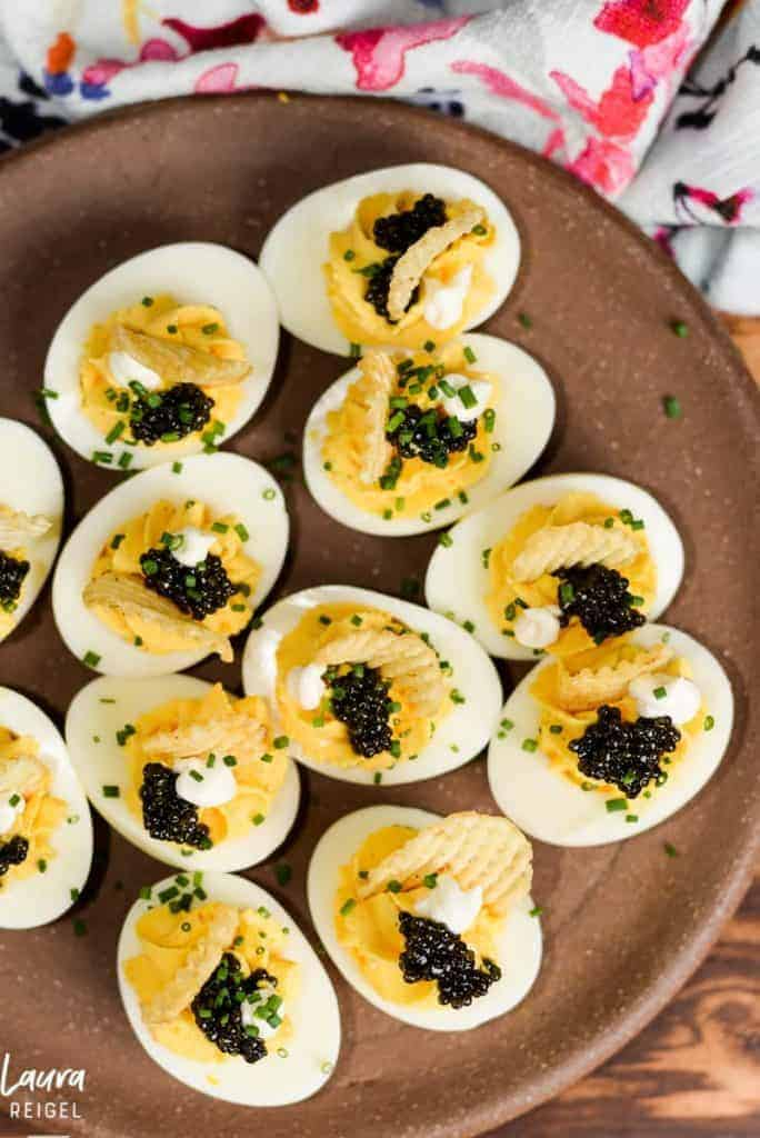 Deviled eggs with caviar and potato chips.
