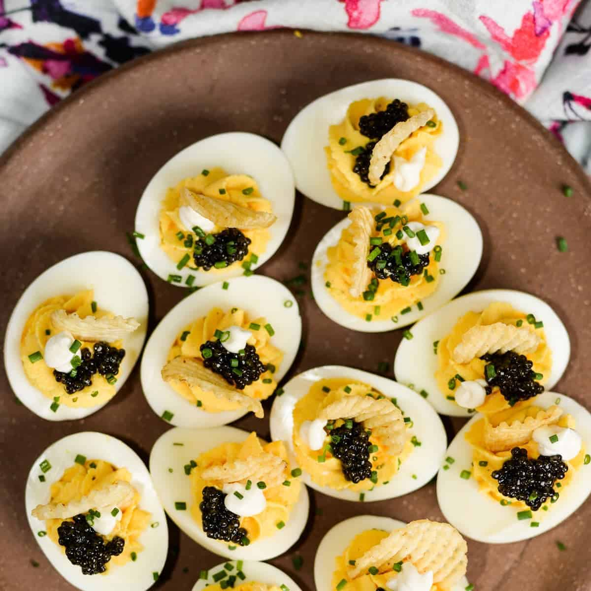 Unpretentiously fancy deviled eggs with caviar and potato chips.