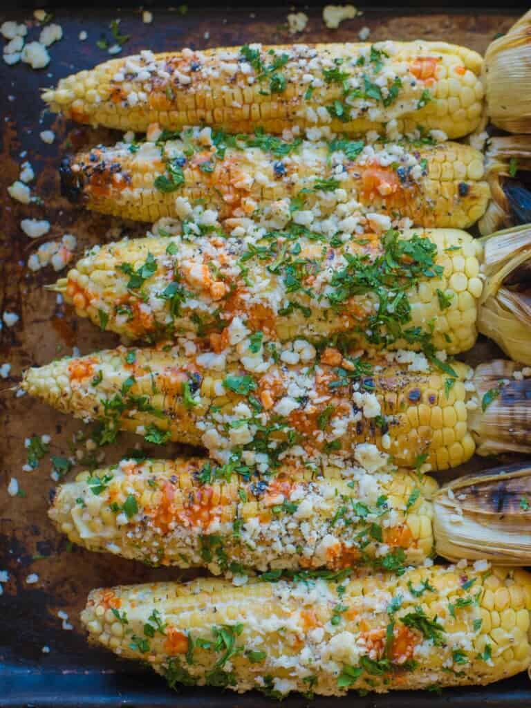 Mexican grilled corn with cotija and hot sauce