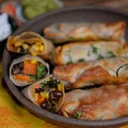 Southwest egg rolls baked. Filled with black beans, sweet potatoes, and fresh corn.