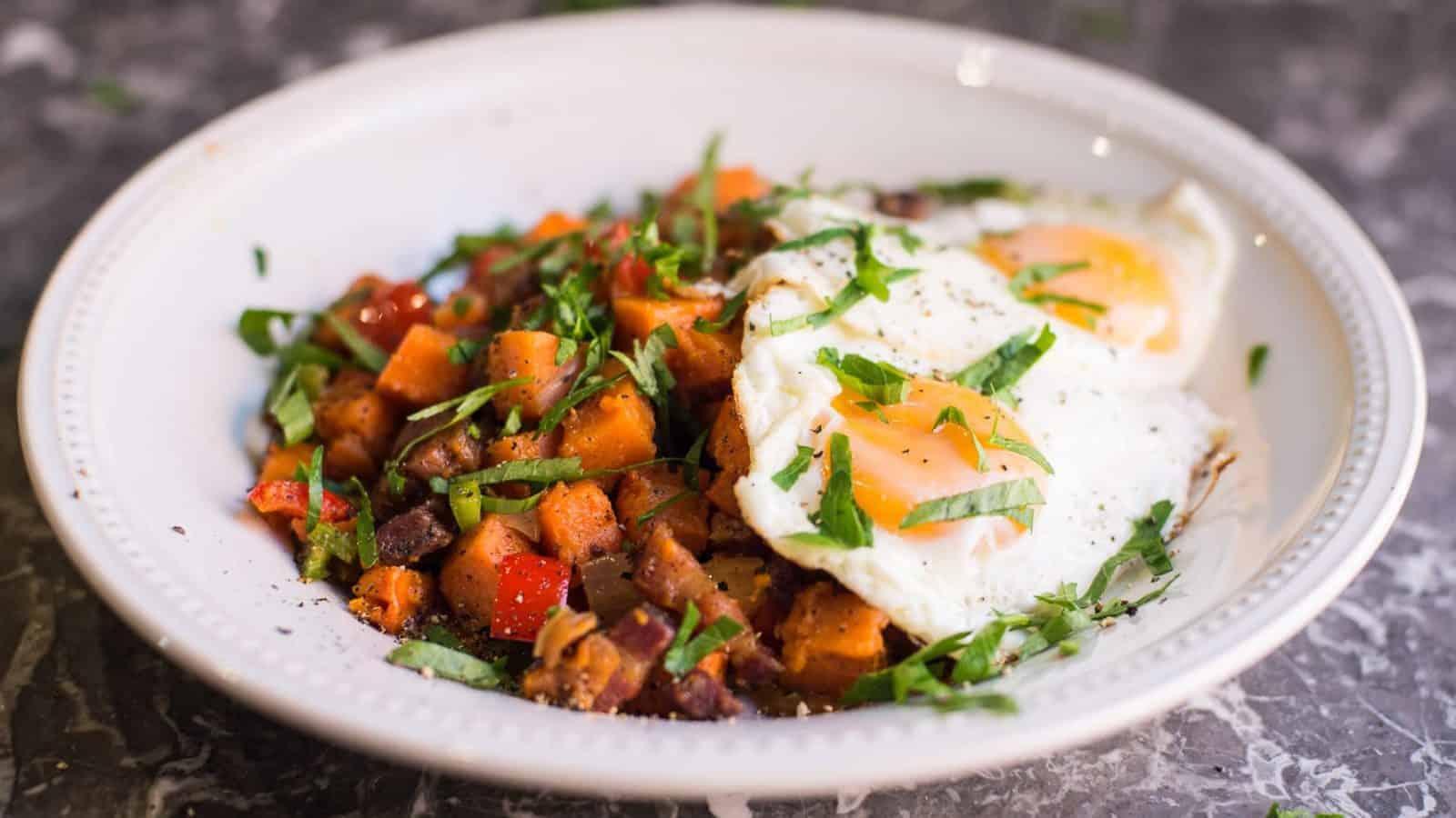 Paleo breakfast hash. Sweet potato hash with sunny side up eggs.