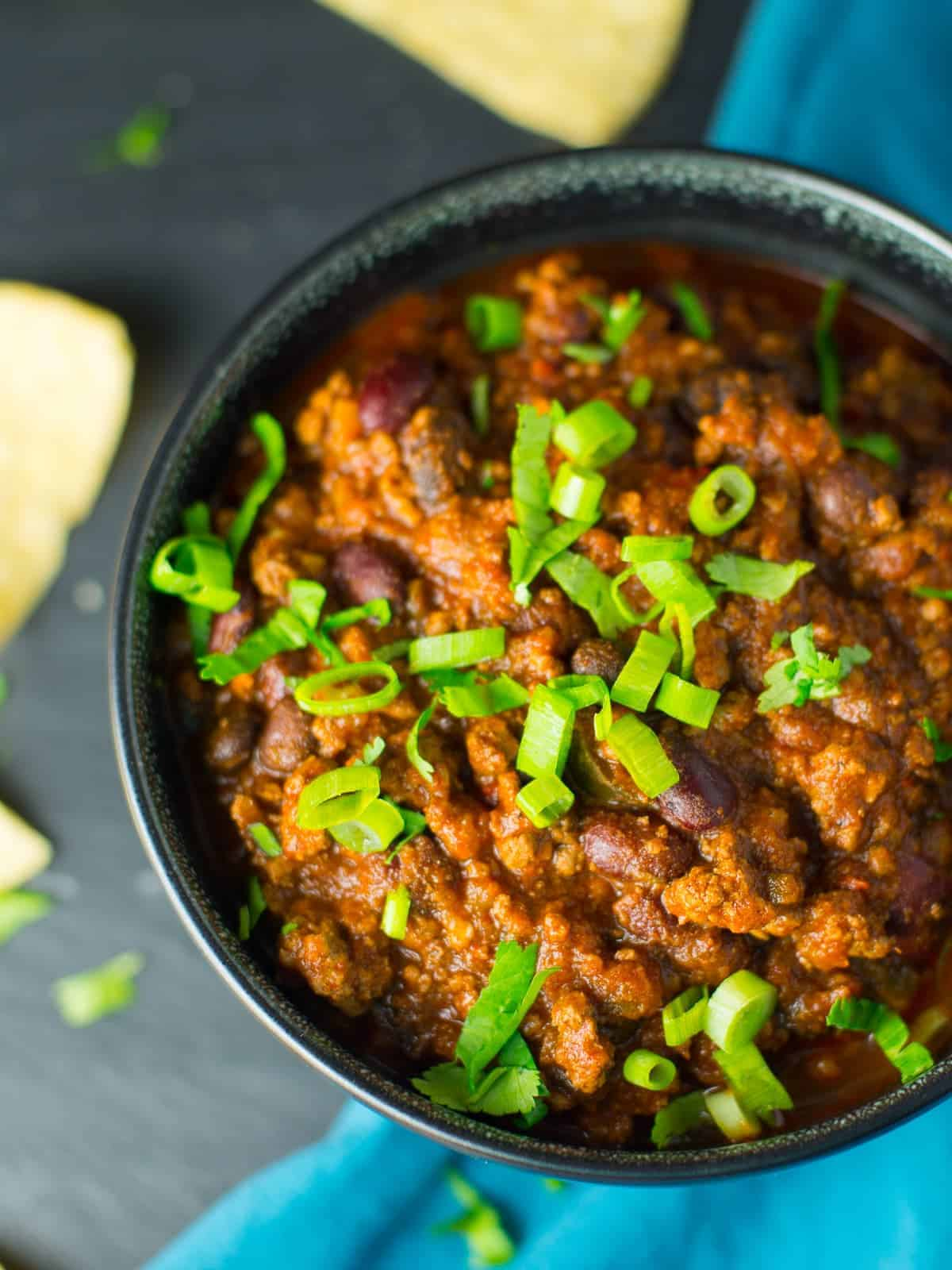 Easy chili recipe topped with fresh green onions.