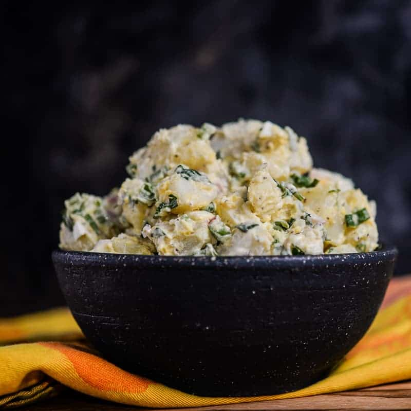 Big bowl of creamy potato salad. The perfect summer recipe for your fourth of July barbecue.
