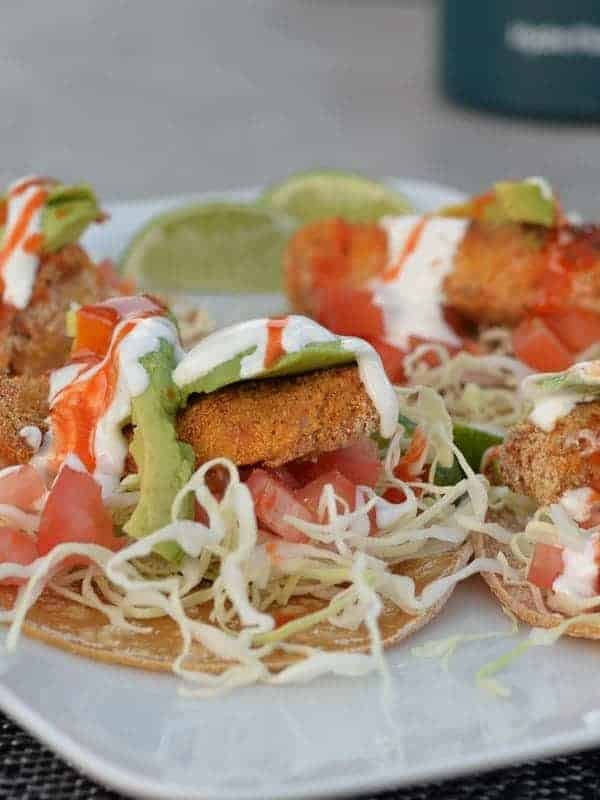 Baja fish tacos cooked in an airfryer. Street taco sized corn tortillas and white sauce make these super authentic.