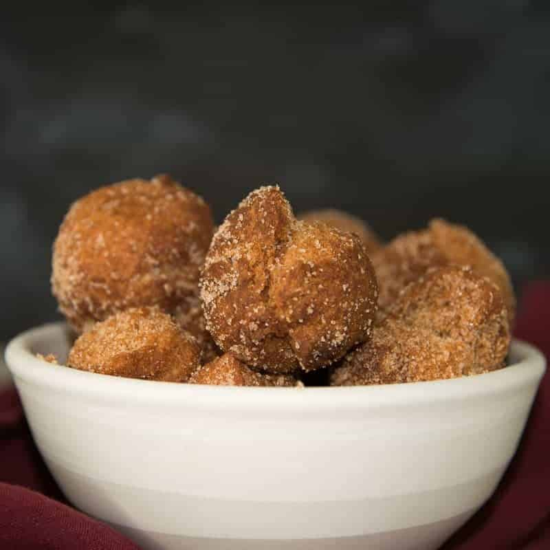 Apple Cider Donut Holes rolled in sugar. recipe by foodology geek.