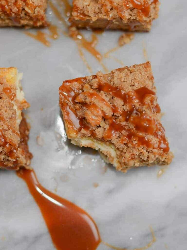 pumpkin cheesecake bars with cinnamon streusel and caramel sauce
