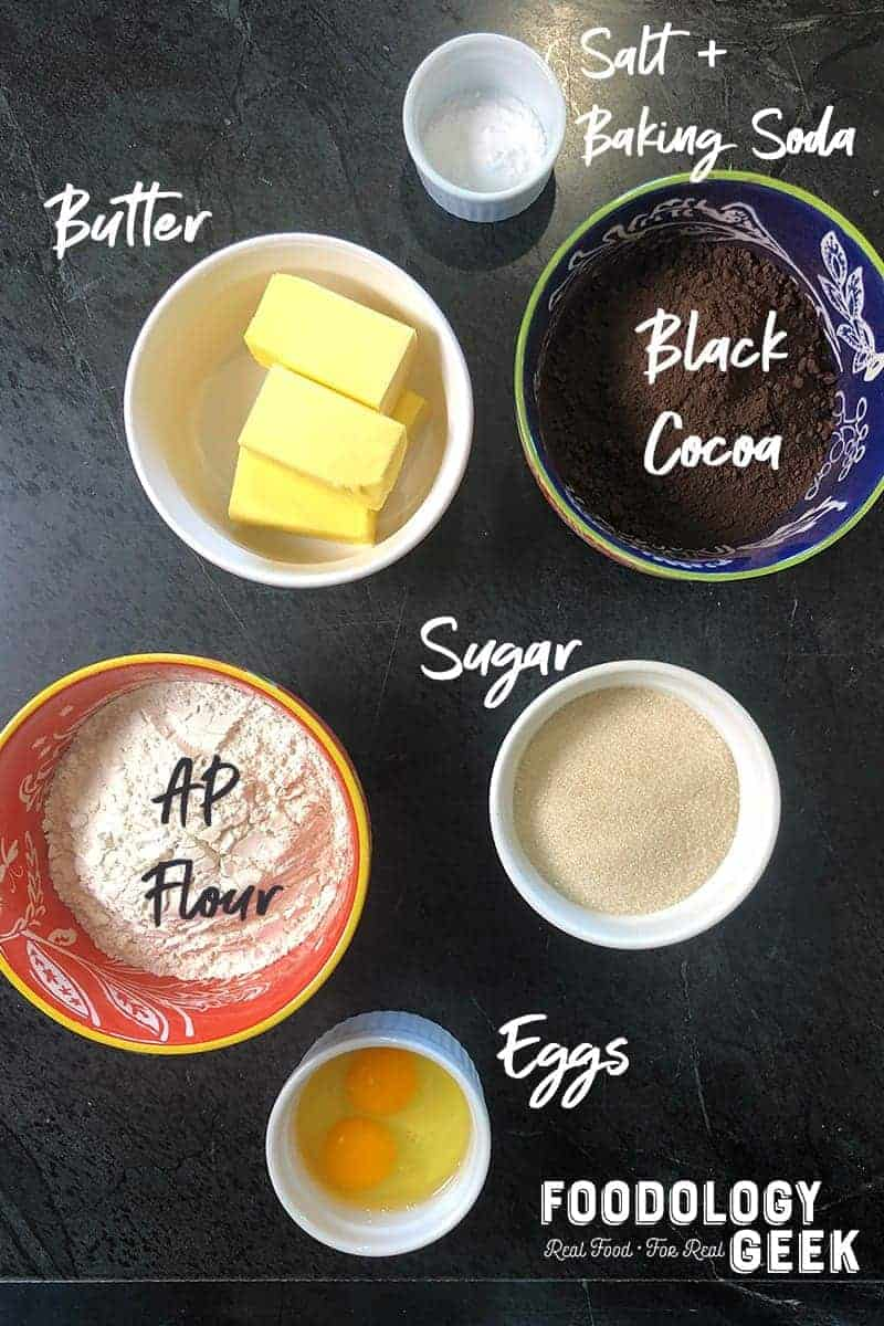Ingredients for chocolate sandwich cookie dough. Butter, sugar, flour, salt, baking soda, cocoa.