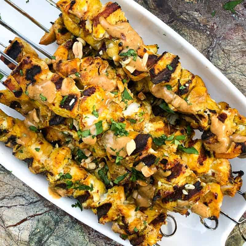 Chicken satay recipe. Grilled chicken skewers with satay sauce.