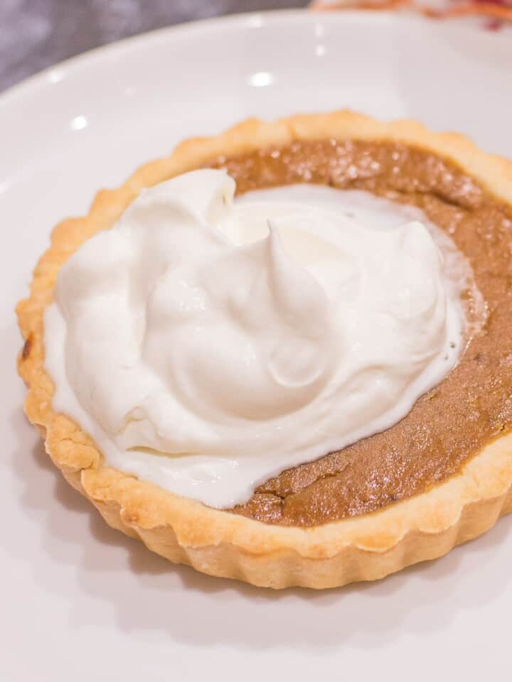 mini pumpkin pies with whipped cream