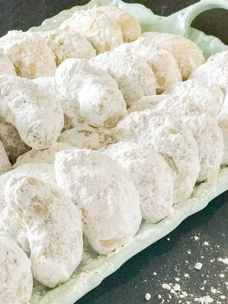Pecan cookies rolled in powdered sugar