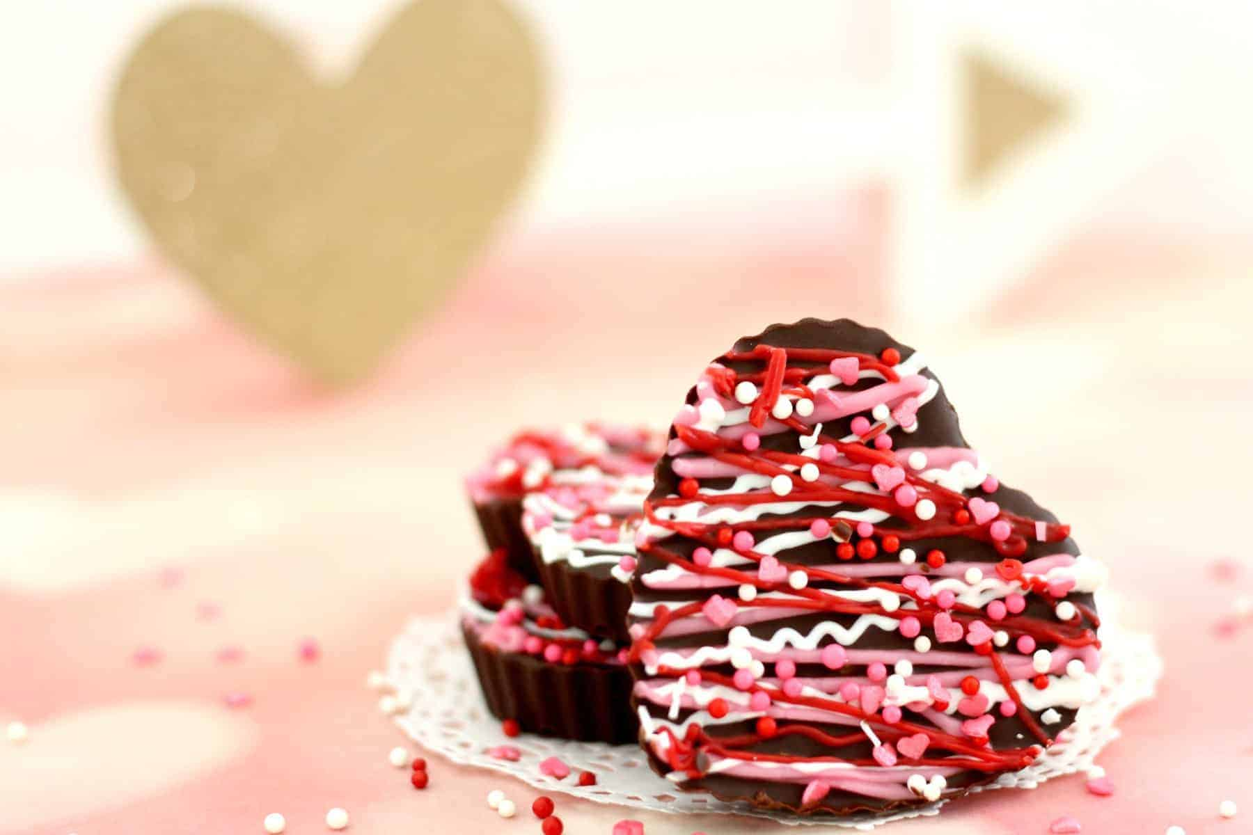 homemade dark chocolate hearts decorated with sprinkles