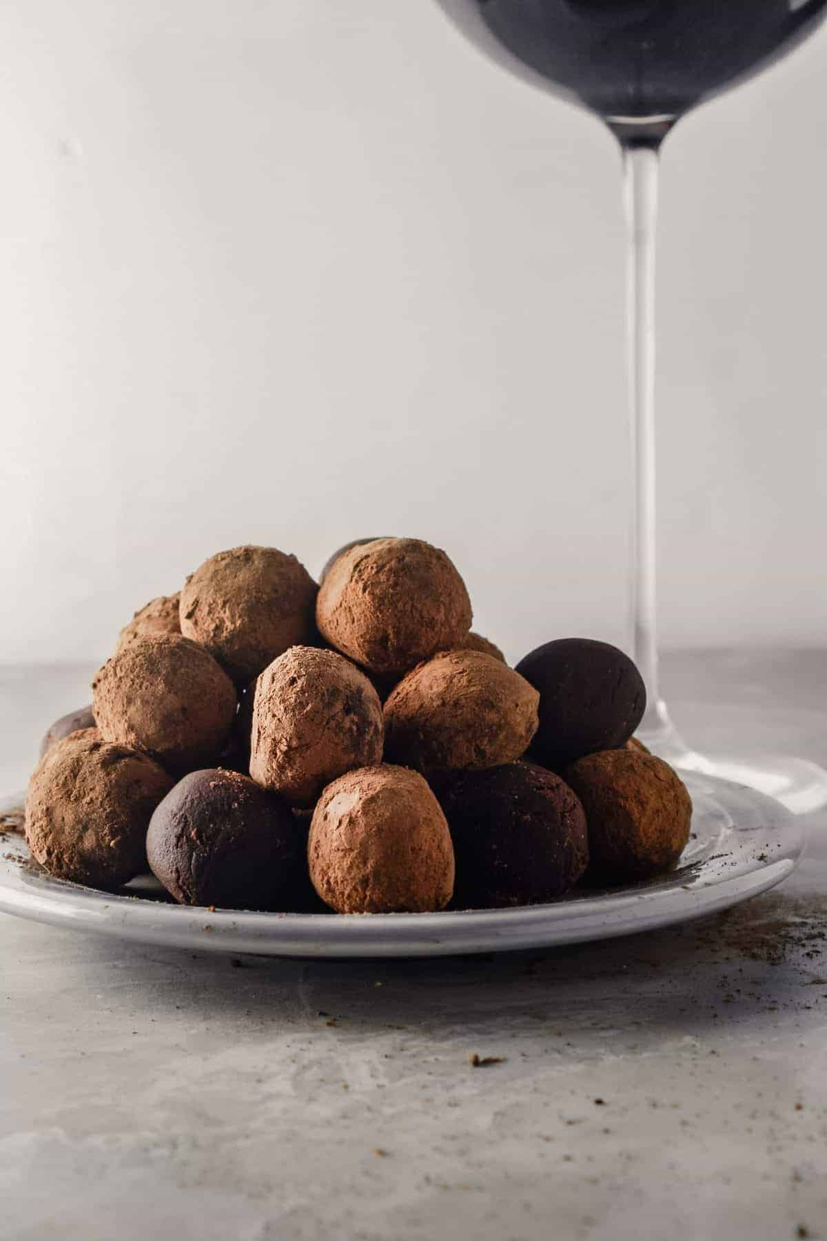 A plateful of truffles made with dark chocolate and red wine.