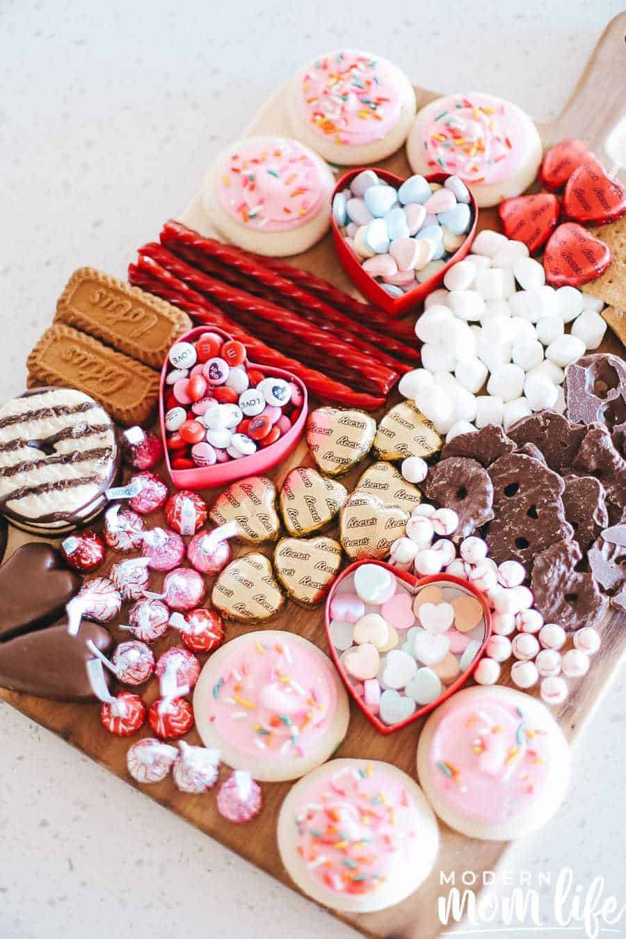 Dessert board filled with Valentines candies, cookies, and chocolates.
