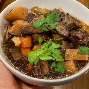 Low carb beef stew in a white bowl.