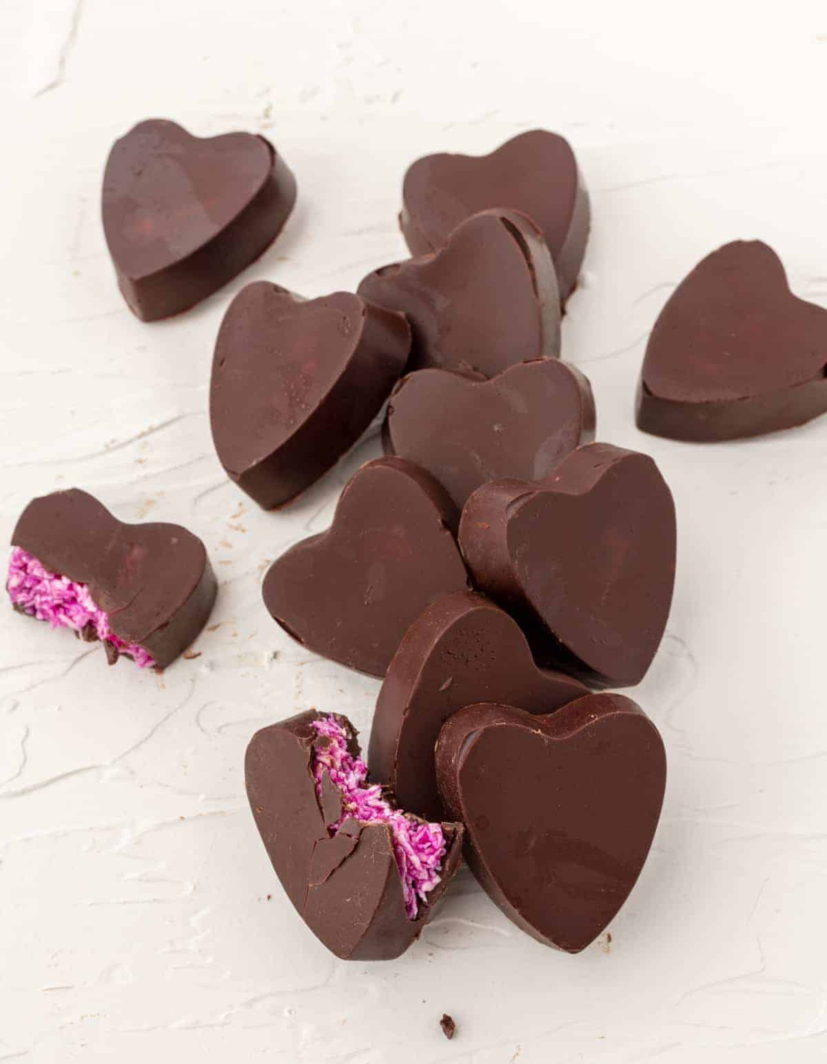 Heart shaped copy cat mounds candies. bright pink inside. vegan candy recipe.
