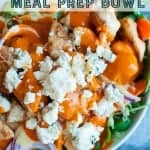 haelthy buffalo chicken meal prep bowl. Buffalo chicken on top of veggies served with a buffalo ranch dressing. healthy meal prep bowl. Pinterest image by foodology geek.