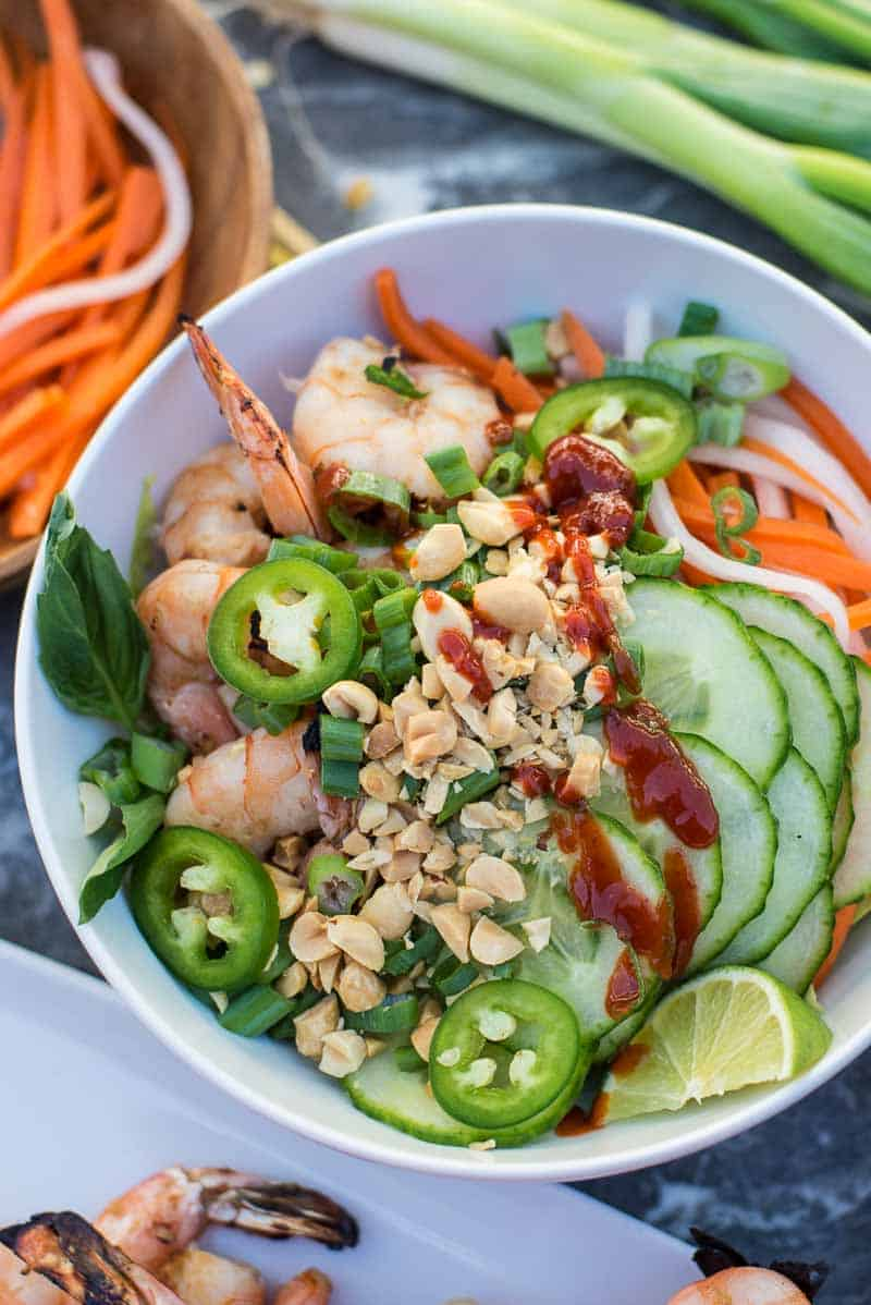 Vietnamese lemongrass shrimp bowl. Served with grilled lemongrass shrimp, fresh cucumbers, carrots, and bean sprouts. Topped off with fresh basil, crushed peanuts and sriracha.
