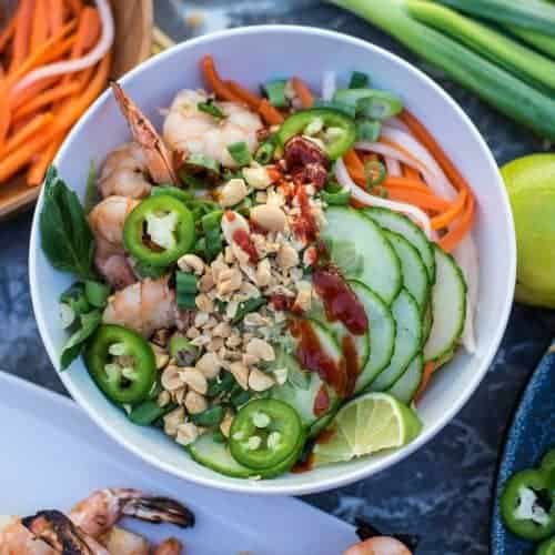 Lemongrass shrimp, grilled and served with vermicelli noodles, fresh vegetables, fresh basil and bean sprouts.