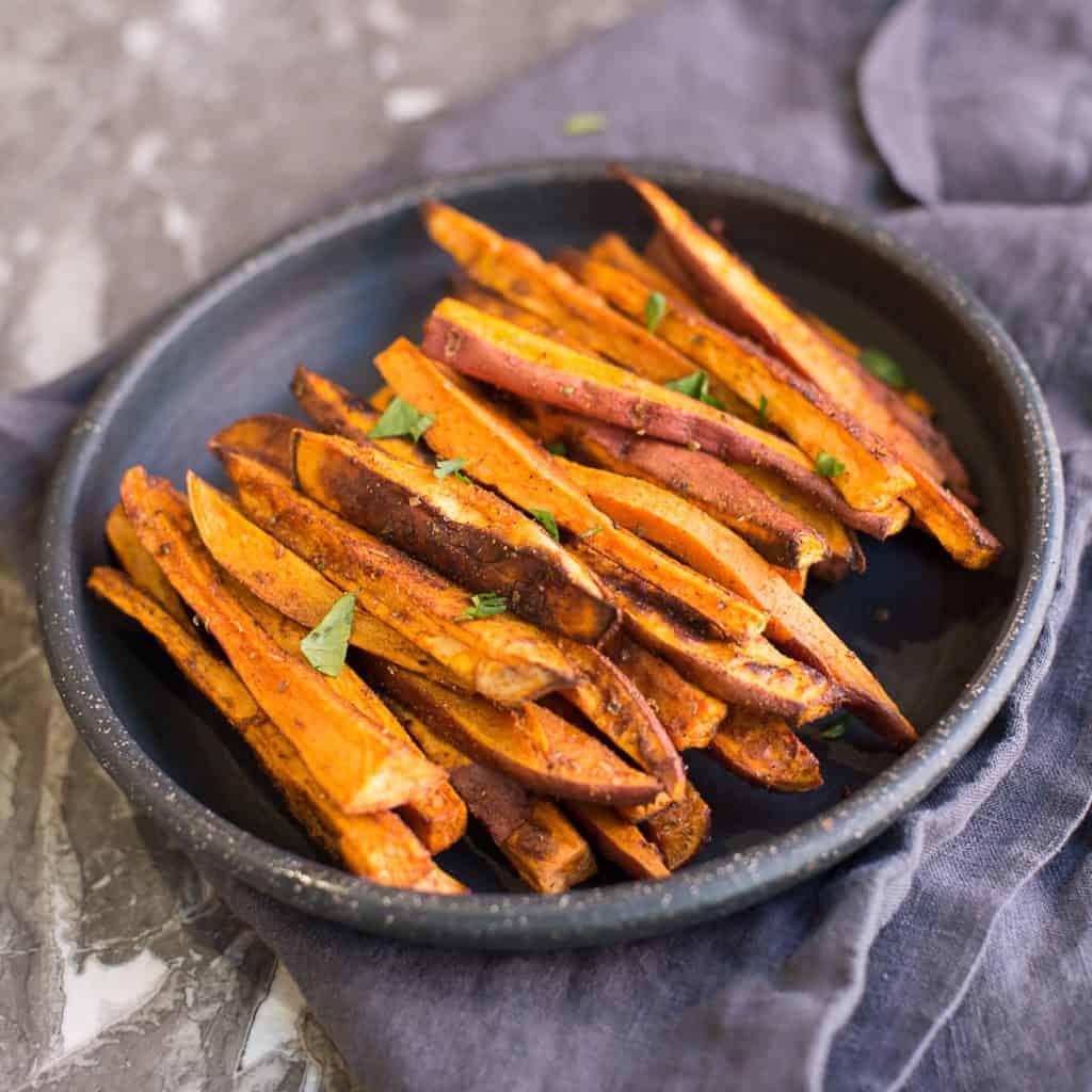 A plate of baked sweet potato fries